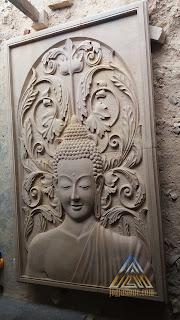 Relief dari batu alam paras jogja motif budha