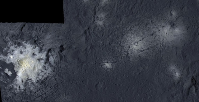 False color mosaic showing parts of Occator crater. The images were taken from a distance of 375 kilometers. The left side of the mosaic shows the central pit containing the brightest material on Ceres. It measures 11 kilometers in diameter and is partly surrounded by jagged mountains. In the middle of the pit a dome towers 400 meters high covered by fractures. It has a diameter of three kilometers. The right side of the mosaic shows further, less bright spots in Occator crater. Credit: NASA/JPL-Caltech/UCLA/MPS/DLR/IDA