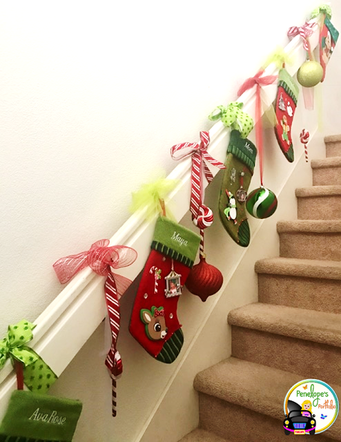 Stockings hung from ribbon on staircase