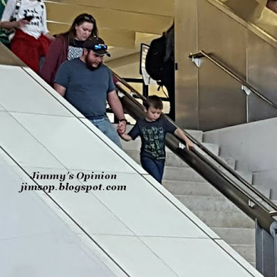 Our son Tim with his wife Elisa and their son Benjamin walking together down the stairs arriving at the airport