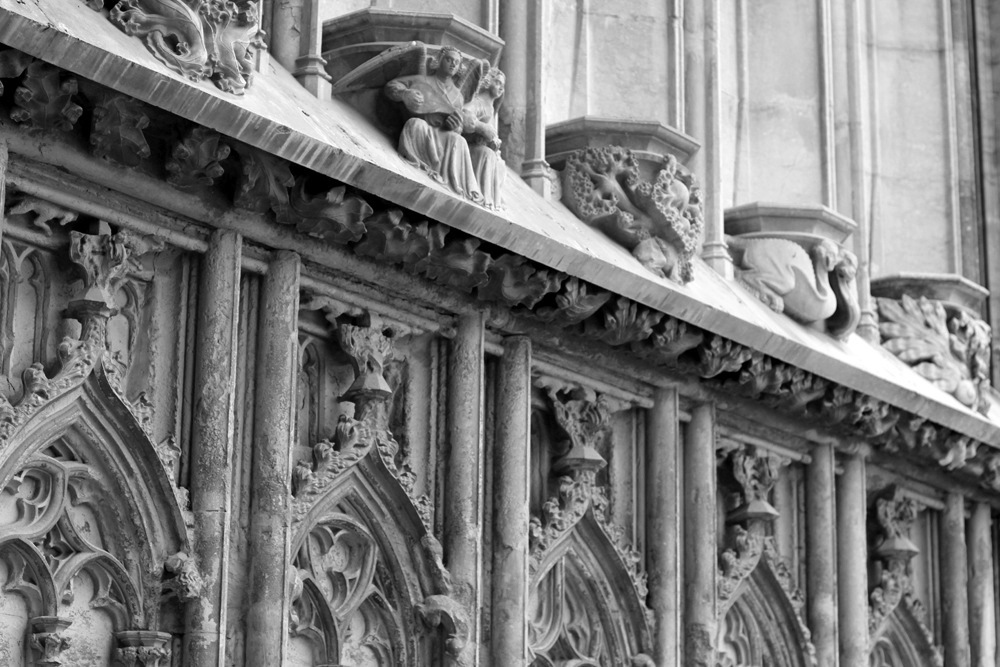 Carved stone church details in Girona, Spain - travel & lifestyle blog