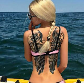 tattoo de alas en la espalda