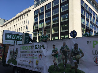 Pic of Irish Rugby float with banner for special St Patrick's Day game