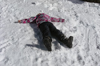 Image result for kids making snow angels