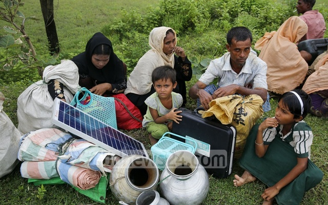 Refugees used the panels, each the size of a laptop computer and fitted with a battery and a small light, to charge mobile phones and provide light at night on the jungle roads to Bangladesh, they said.
