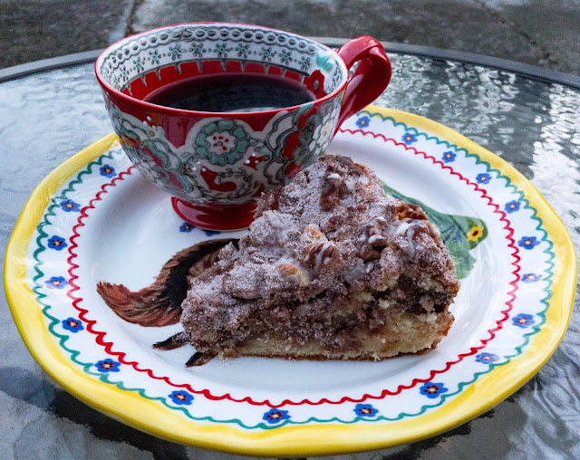 A slice of Duck Egg and Brown Butter Coffee Cake with a cup of Jay D's Single Origin Coffee