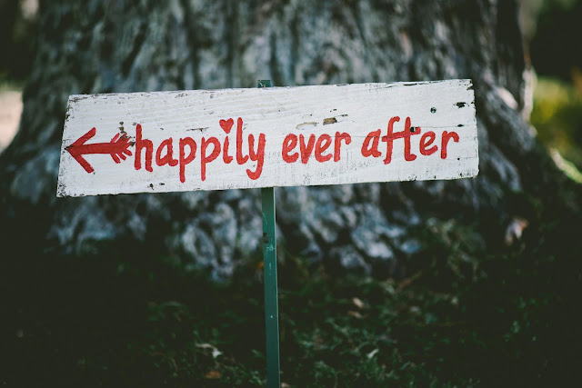 A hand painted sign that says happily ever after