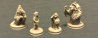 the four miniatures from the game, modelled in simple grey plastic.