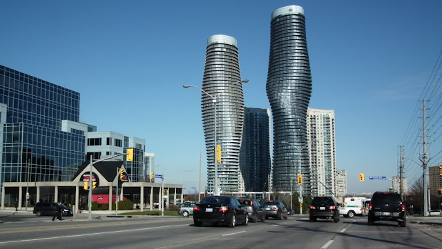 Photo of towers and the city as seen from the street