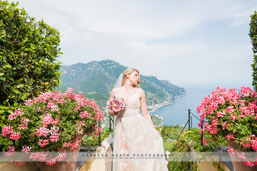 Bride in garden with sea view