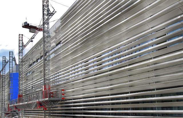 IHU Méditerranée Infection en Marsella. Revestimiento fachada lamas de hormigón ultraligero BFHUP, Fachada de hormigón, Ciprés S.L, Rehabilitación edificio Madrid