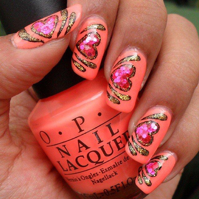 Peach heart nail art