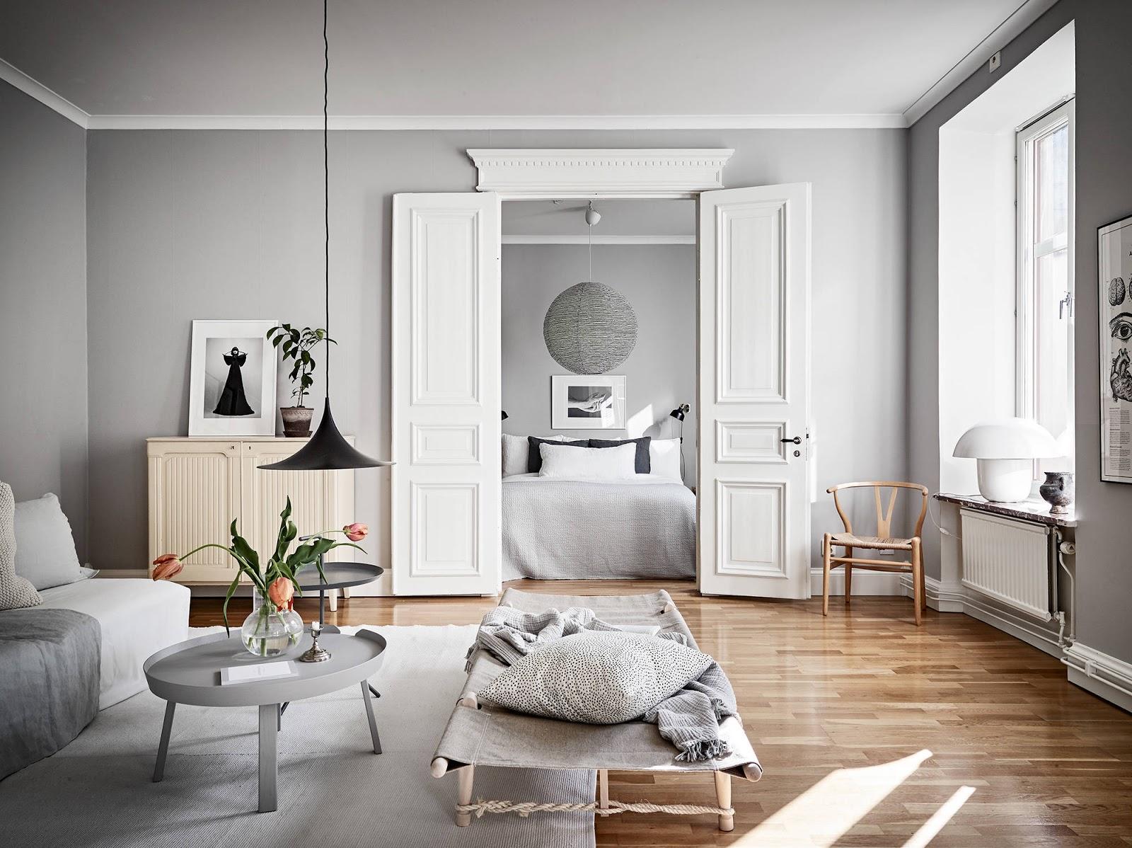 Appartamento con pareti grigie e arredi bianchi arc art for Immagini pareti colorate soggiorno