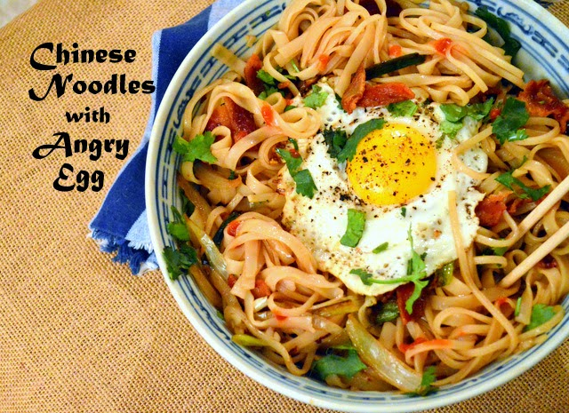chinese noodle bowl with fried egg