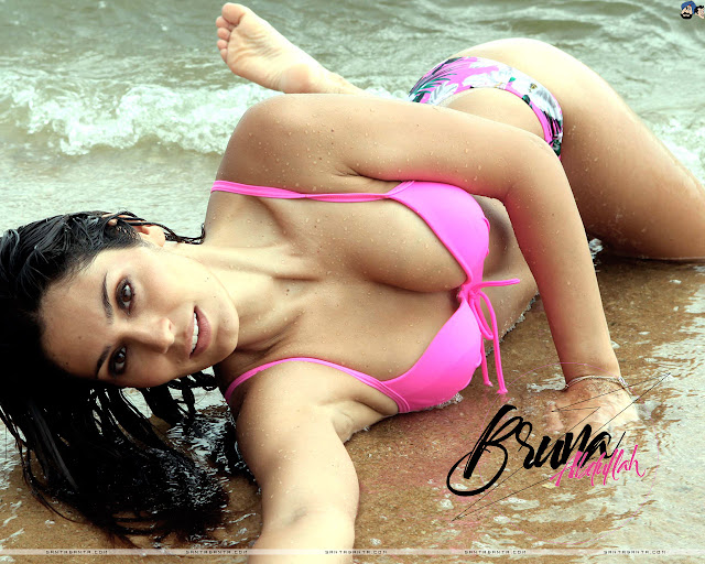 Bruna Abdullah in pink bikini on a beach