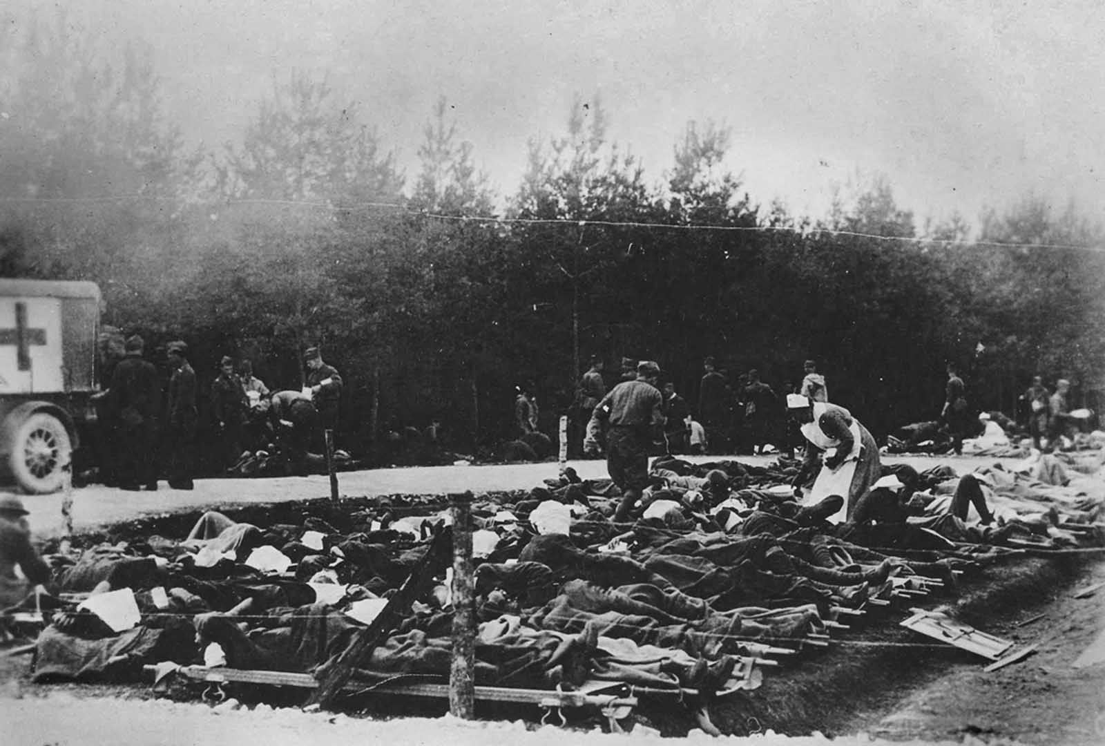 Gassed patients are treated at the 326th Field Hospital near Royaumeix, France, on August 8, 1918. The hospital was not large enough to accommodate the large number of patients.