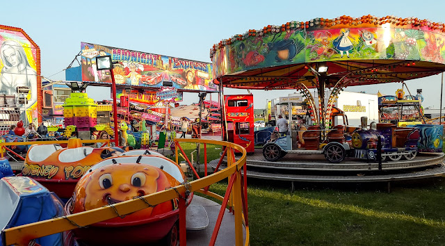 Photo of the colourful fairground rides