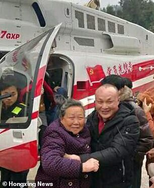 Chinese tycoon showers villagers in hometown with gifts worth £1.4m including cash and TV sets
