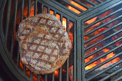 Certified Angus Beef Brand ribeye steak on a kamado grill with Craycort Cast Iron Grates