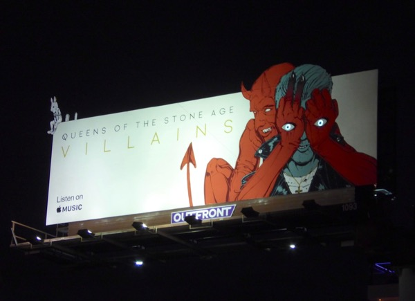 Queens Stone Age Villains glowing eyes billboard