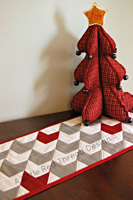 http://tumus.blogspot.co.uk/2014/11/blog-hop-mod-winter-table-runner.html