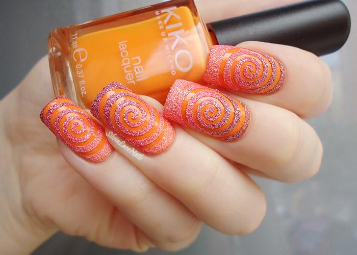 Orange texture spiral nail art
