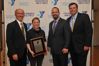 Photo L-R: Hockomock Area YMCA President Ed Hurley; Franklin Food Pantry Executive Director Erin Lynch; Bernon Family Branch Board of Manager Chair Bill Chouinard, and Hockomock Area YMCA Board of Directors Chairman Brian Earley