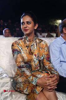Actress Rakul Preet Singh Stills in Short Dress at Dhruva Pre Release Function  0044.JPG