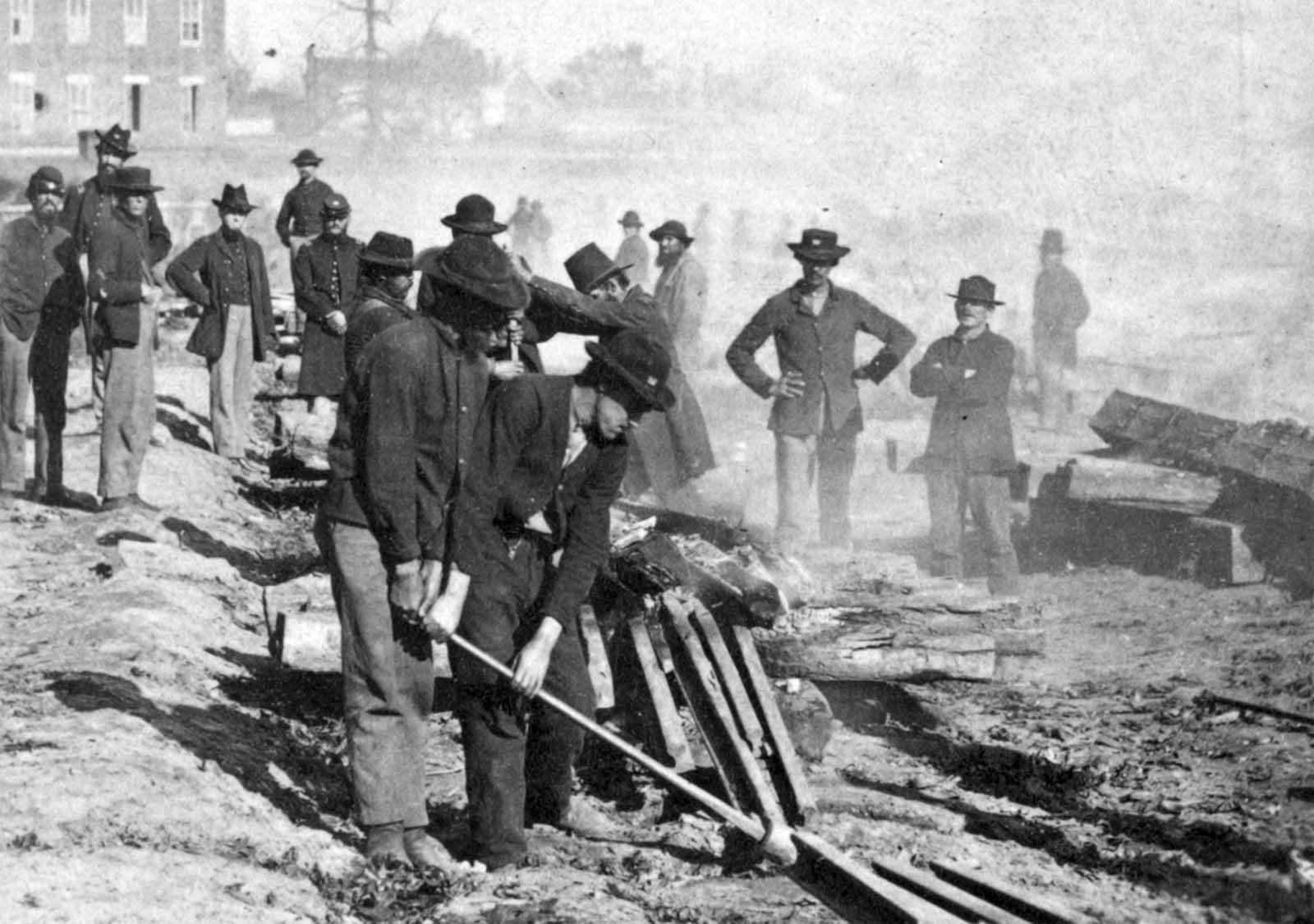 General Sherman's men destroying the railroad before the evacuation of Atlanta, Georgia in 1864.