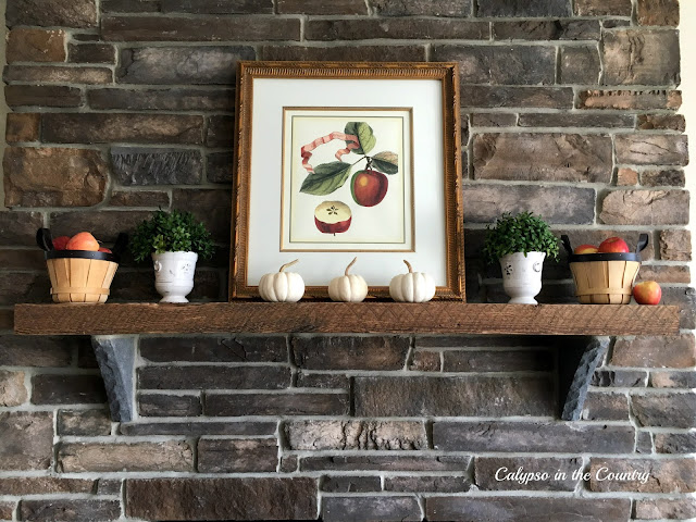 Rustic Mantel Decorated for Fall with Apples and Pumpkins