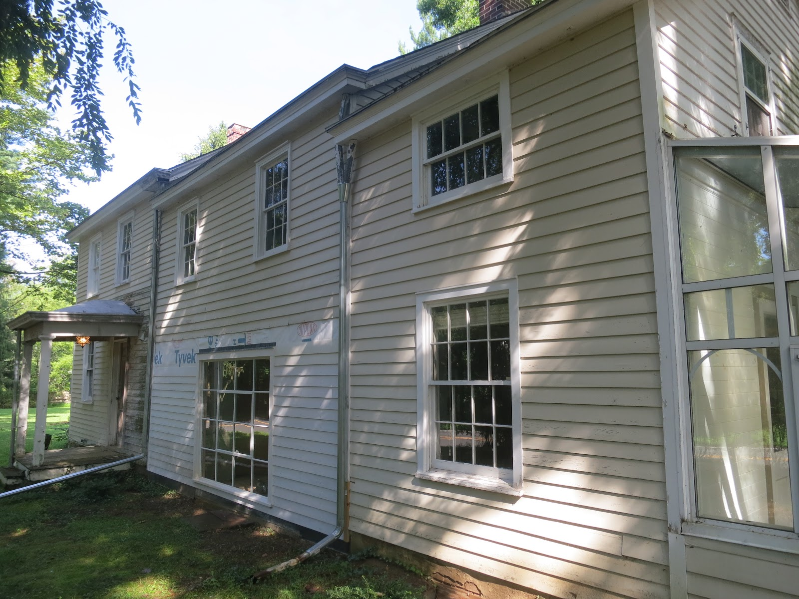 An Old Farm Replacing Old Clapboard Siding
