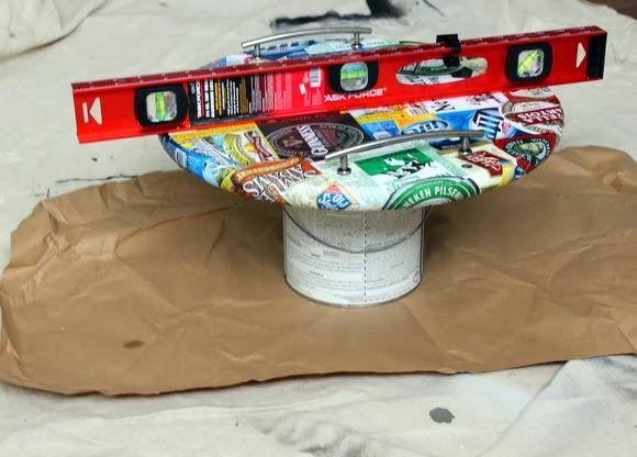 Keep the tray level as you waterproof it: DIY Beer Tray | DIY Playbook