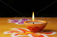 rangoli decoration with diyas