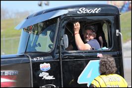 Scott Treadway relaxes in his #4 truck prior to the Bandit race at Motor  Mile Speedway on Saturday, April 21, 2018