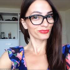 photo of attractive brunette in over sized glasses and with bright red lipstick