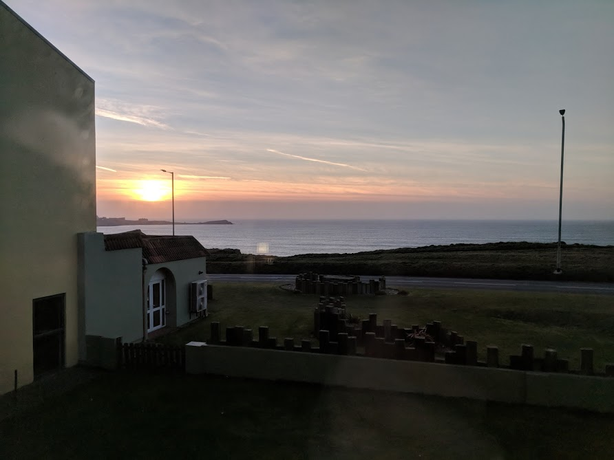 The Sands Resort Cornwall Review | A Family Hotel with Kids Club near Newquay  - sunset view from contemporary bedroom
