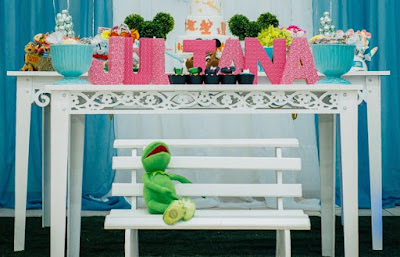 Use stuffed animals of your favorite Disney characters as photo props at a Disney birthday party.