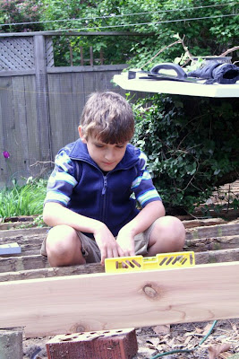 William making sure the frame is properly inclined :: The Deck Odyssey (All Pretty Things)