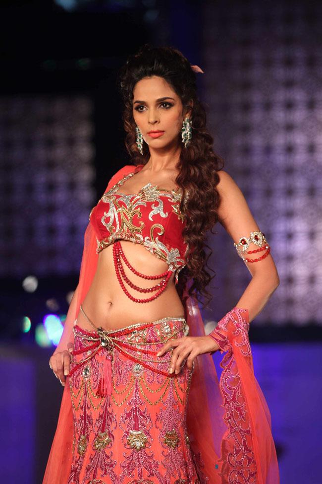 Mallika sherawat curves in bridal dress,