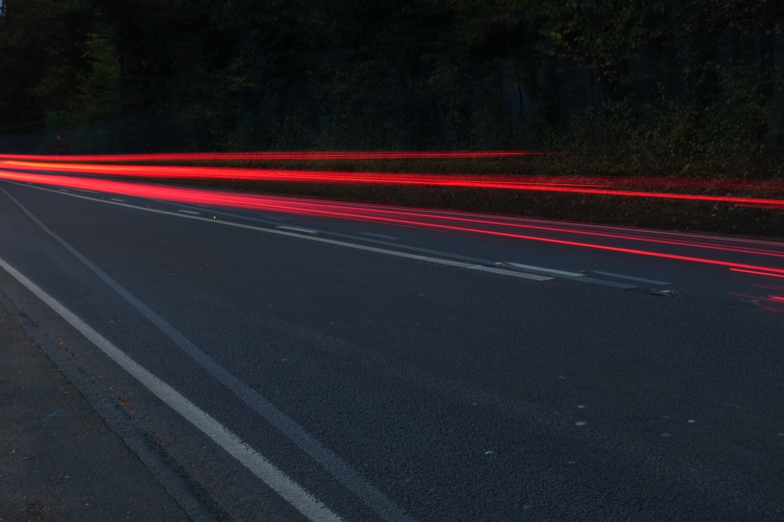 A road with red lights caused by car tail lights taken on a slow shutter speed