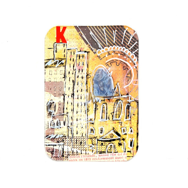 Stamped and Painted Cityscape with King Kong Sticker on Acrylic