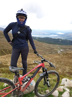 woman seneca chino pants in the hills with mountain bike