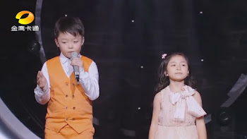 Çinli Çocuklardan Müthiş Düet Performansı