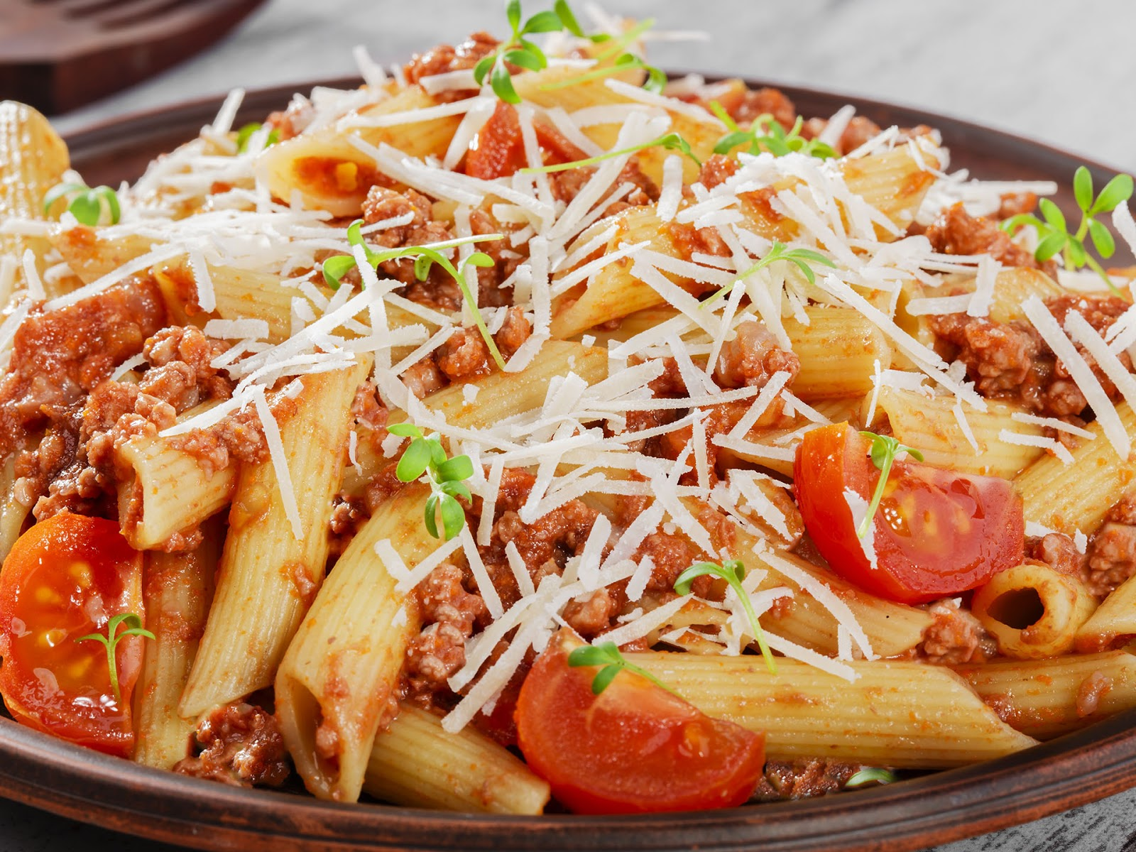 Pasta is not a whole food as it is typically made from processed wheat and eggs.