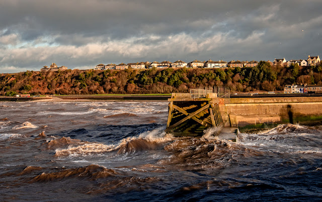Photo of Maryport's north pier in a choppy sea