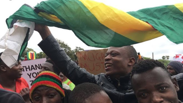 Exuberant crowds gathered on Zimbabwean streets