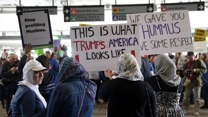 Trump signs new Muslim travel ban excluding Iraq