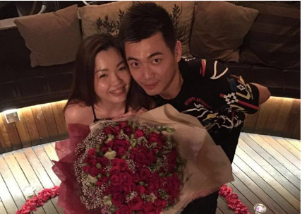 Tan Wee Kiong and fiancee. He successfully proposed to his fiancee this year May, and now they are preparing for their wedding.