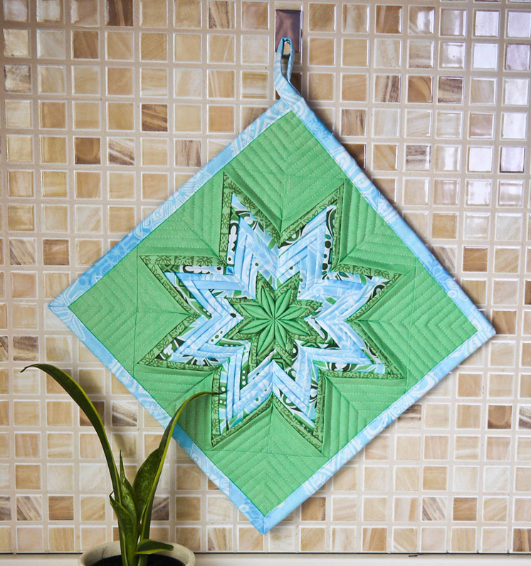 Fancy Folded Star Pot Holder. Patchwork