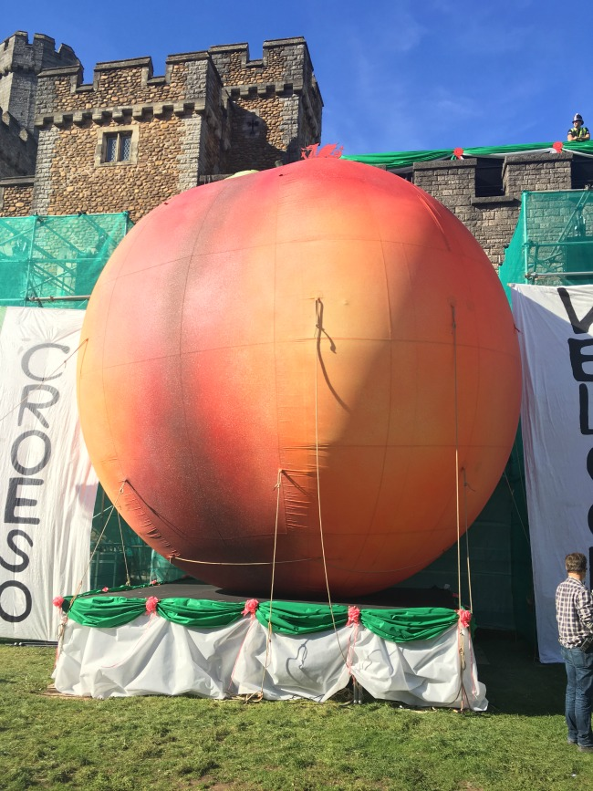 City-Of-The-Unexpected-Cardiff-Celebrates-Roald-Dahl-Giant-peach-in-front-of-castle